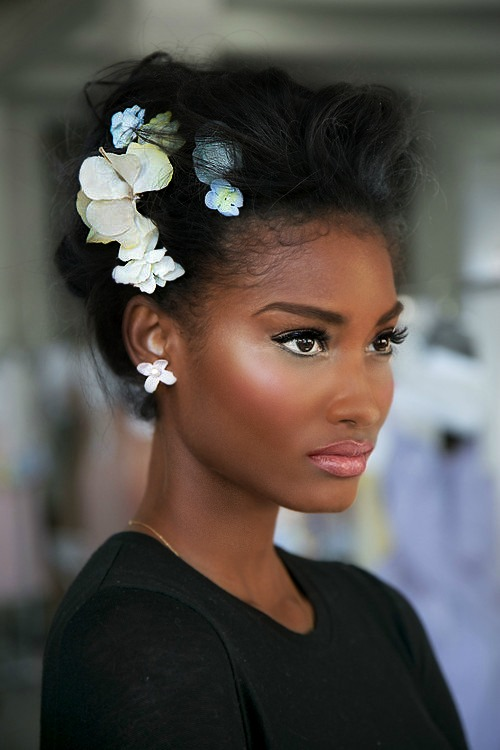 Dark Skin Model with Flowers in Hair