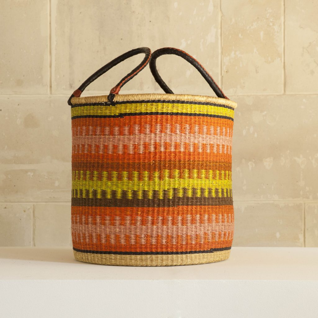 Laundry basket with leather handles.